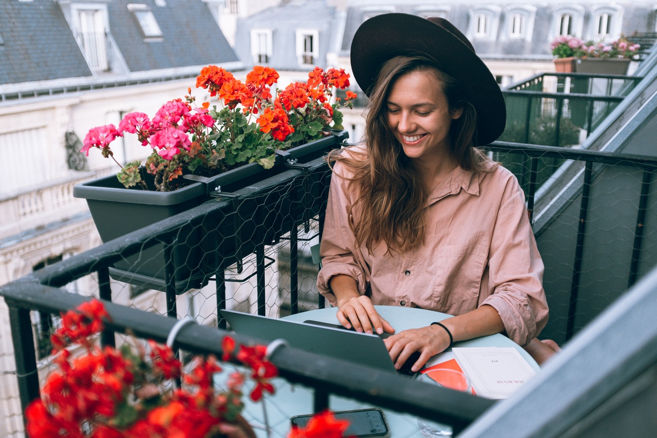woman-wearing-beige-dress-shirt-using-laptop-computer-3277932